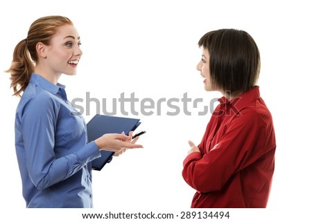 Two business woman chatting away together  - stock photo