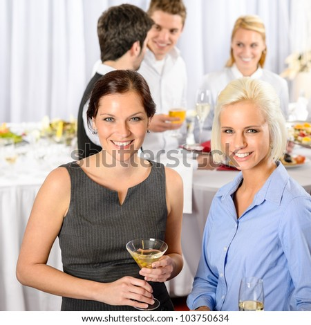 Two business woman smiling at catering buffet company meeting - stock photo