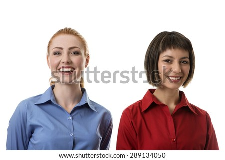 two business woman with different face expressions sanding side by side of happiness