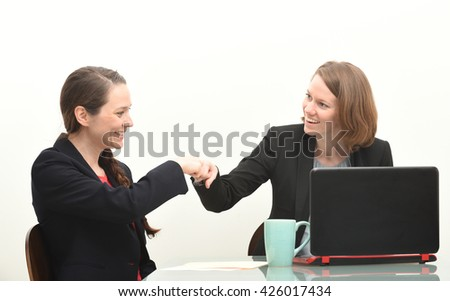 Two business women and fist bump - stock photo