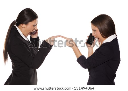 Two business women argue Talking on the phone - stock photo