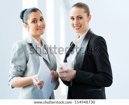 two business women discussing documents in the office - stock photo