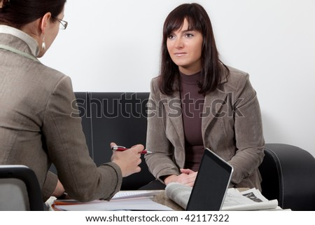 two business women having a meeting at the office - stock photo