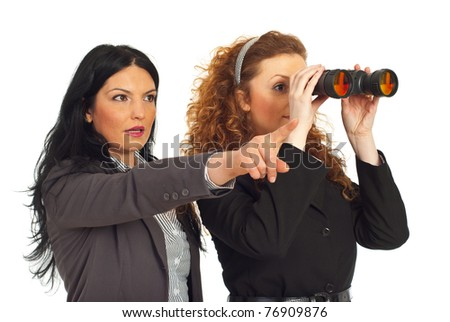 Two business women pointing and looking into binocular to the future  isolated on white background - stock photo