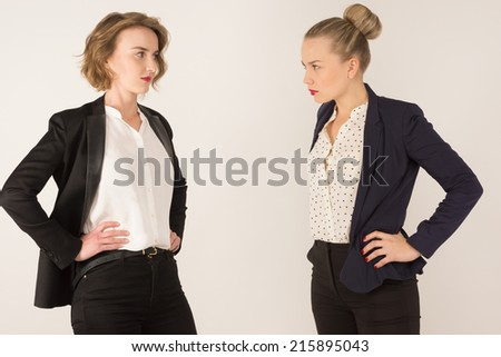 two business women swear on a white background