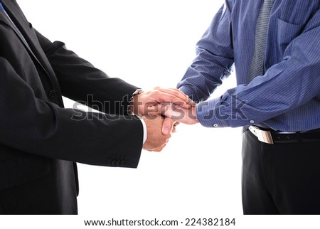 Two businessman giving handshake isolated on white background - stock photo