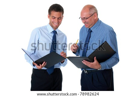 two businessman in blue shirts check and discuss their documents, isolated on white background