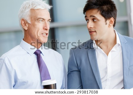 Two businessman in office having discussion - stock photo
