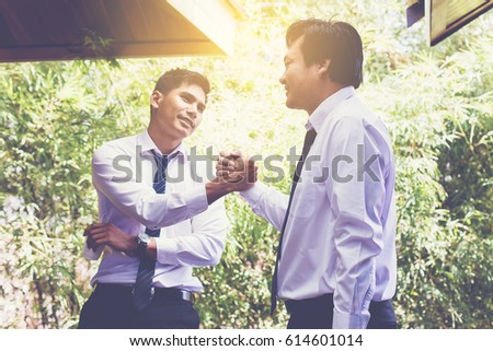 two businessman join hand after business meeting. coffee break