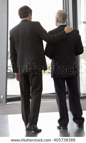 Two businessman leaving an office building