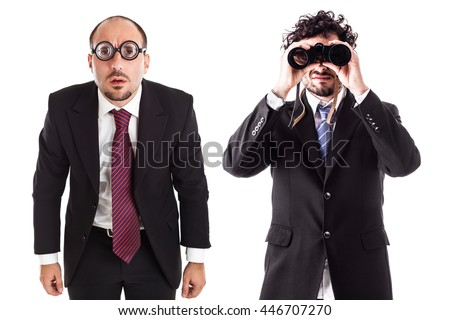 two businessman one with thick glasses and one with a binocular isolated over a white background - stock photo