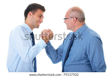 two businessman seal deal, agreement, senior one and younger one, both wear blue shirts and ties, welcome friendly handshake, isolated on white
