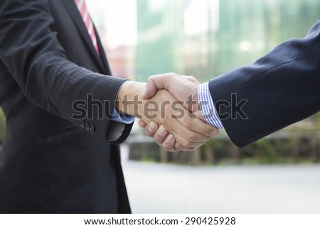 Two businessman shaking hands - stock photo