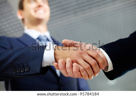 Two businessman shaking hands greeting each other - stock photo