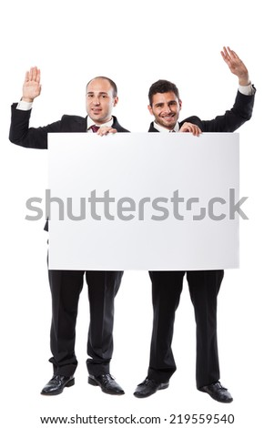 Two Businessman standing on a white background holding a billboard - stock photo