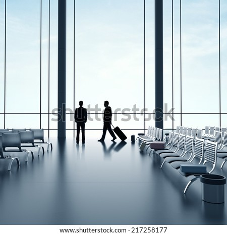 two businessmans walking in airport with luggage