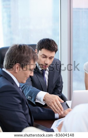 Two businessmen are discussing in the office - stock photo