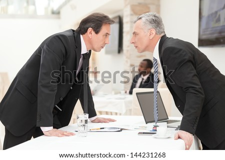 Two businessmen are trying to come to an agreement. - stock photo