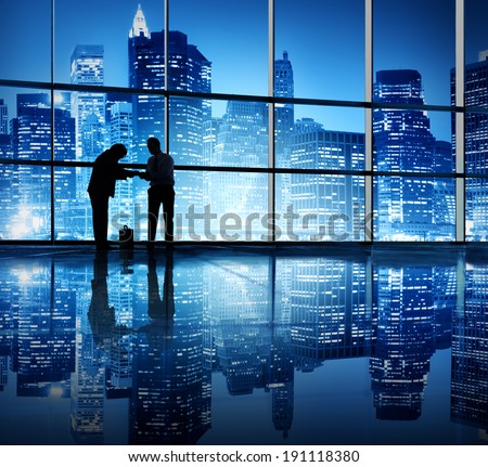 Two businessmen bonding in an office building.