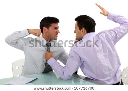 Two businessmen coming to blows - stock photo