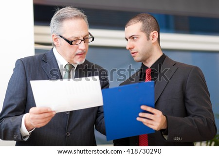 Two businessmen discussing - stock photo