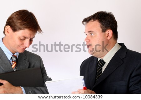 Two businessmen discussing a report