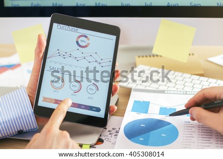 Two businessmen discussing business chart on tablet - stock photo