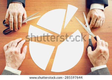 Two businessmen divide in parts the profit between themselves - stock photo