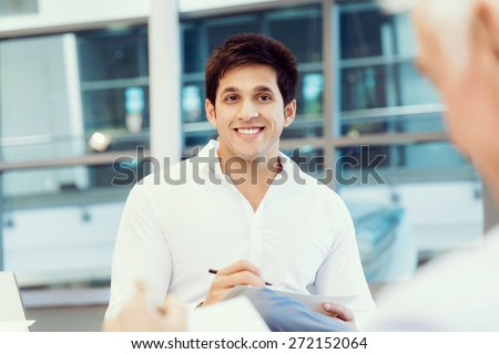 Two businessmen during interview in office - stock photo