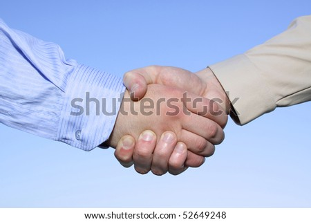 Two businessmen hands handshake isolated on sky background
