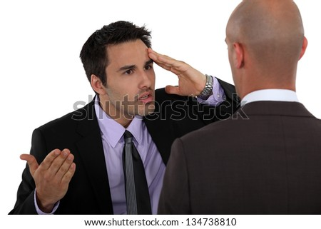 Two businessmen having a difference of opinion - stock photo