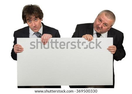 two businessmen holding a big blank sign  isolated on white background - stock photo