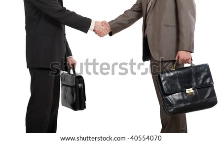 Two businessmen holding briefcases and shaking hands over white background