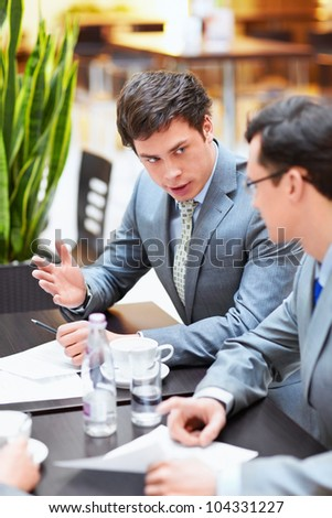 Two businessmen in an office