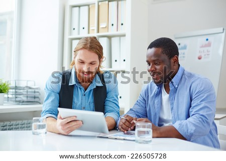 Two businessmen in casual networking in office - stock photo