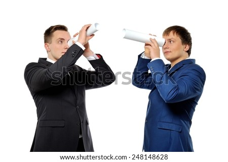 Two businessmen looking through a rolled paper. Business vision, competitors tracking or headhunters concept.  - stock photo