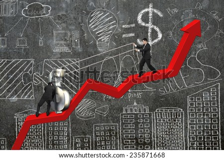 two businessmen moving 3D dollar sign upward on red trend chart with business concept doodles concrete wall background - stock photo