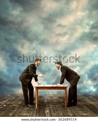 Two Businessmen Negotiating About Business Case