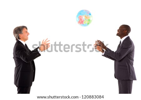 two businessmen playing with a globe - stock photo