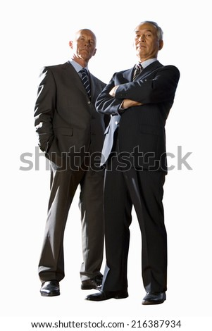 Two businessmen, portrait, low angle view, cut out - stock photo