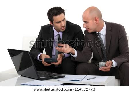 Two businessmen preparing proposal - stock photo
