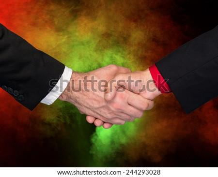 Two businessmen shaking hands. Handshake - stock photo