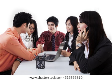 Two businessmen shaking hands in a business meeting, symbolizing business agreement - stock photo