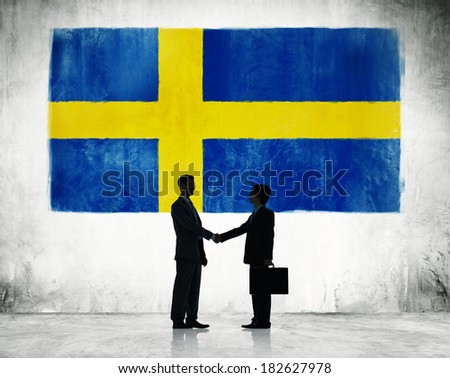 Two Businessmen Shaking Hands With Flag of Sweden - stock photo