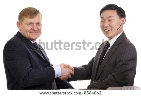Two businessmen shakinghand on a white background. - stock photo