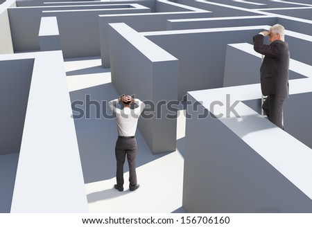 Two businessmen standing in maze being captured - stock photo