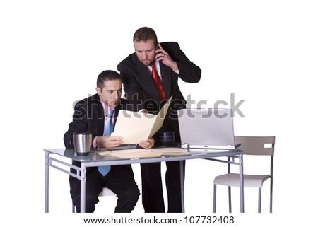 Two Businessmen Standing Up on their Desk  in an Office Working - stock photo