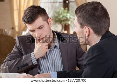 Two businessmen talking about company offer - stock photo