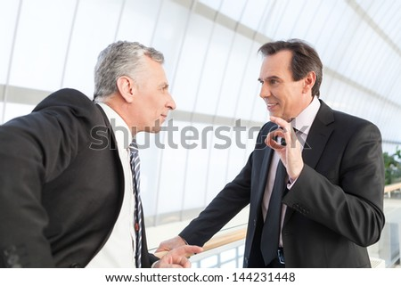 Two businessmen talking to each other - stock photo