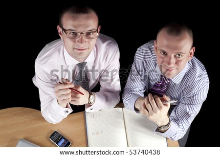 Two businessmen working at laptop - stock photo